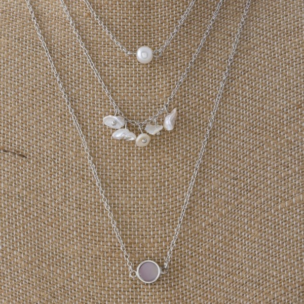 "Dainty metal necklace with pearl detail. Approximately 16-20"" in length."