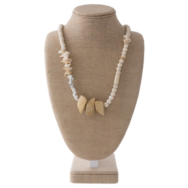 """Long necklace with wooden beads and seashell accents. Approximately 32"""" in length."""