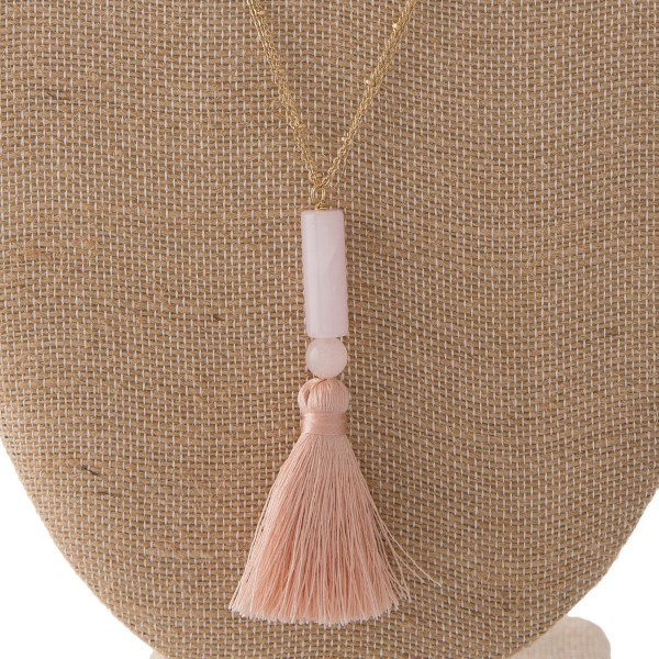"""Long gold tone necklace with natural stone bead and soft thread tassel. Approximately 30"""" in length with a 3"""" pendant/tassel."""