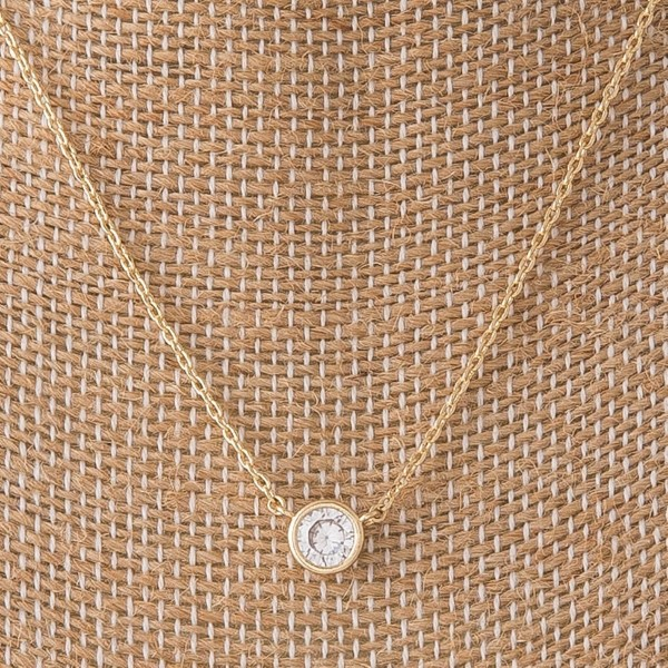 "Dainty necklace with CZ focal. Approximately 18"" in length."