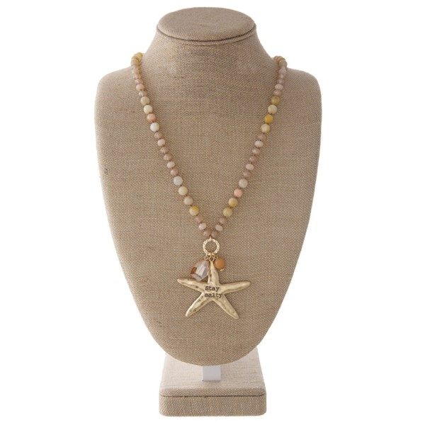 "Long necklace with faceted and natural stone beads and a starfish pendant. Approximately 32"" in length with a 2"" pendant."