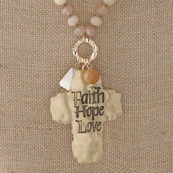 """Long necklace with faceted and natural stone beads and a cross pendant. Approximately 32"""" in length with a 2"""" pendant."""