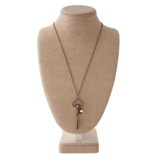"""Long necklace with key pendant with Faith cutout. Approximately 30"""" in length with a 3"""" pendant."""