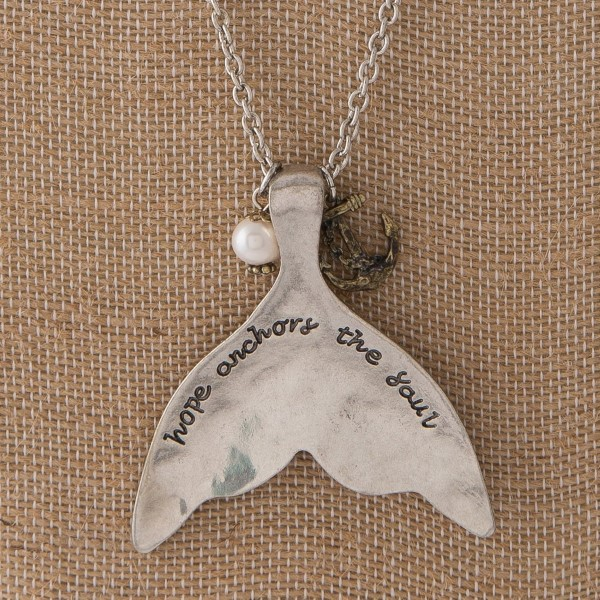 "Long silver tone necklace with sea life charm, pearl accent, and mermaid tail stamped with Hope Anchors the Soul. Approximately 30"" in length with a 2.5"" pendant."