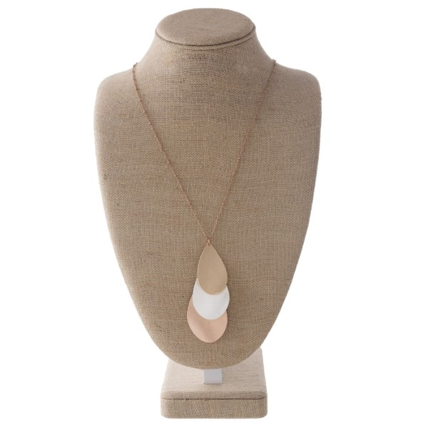 "Long metal necklace with a layered teardrop shape. Approximately 32"" in length."