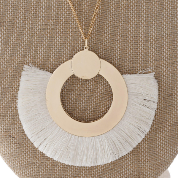 "Long gold tone necklace with fanned tassel pendant. Approximately 2"" x 3"" pendant."