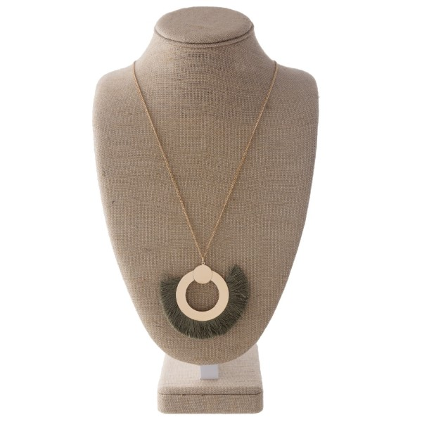 """Long gold tone necklace with fanned tassel pendant. Approximately 2"""" x 3"""" pendant."""