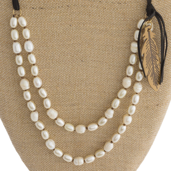 Long Faux leather-doubled pearl necklace with feather charm.