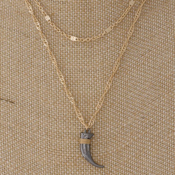 """Layered necklace with horn pendant. Approximately 16-18"""" in length."""
