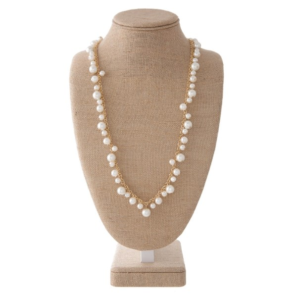 "Long necklace with pearl accents and matching pearl fishhook earrings. Approximately 30"" in length."