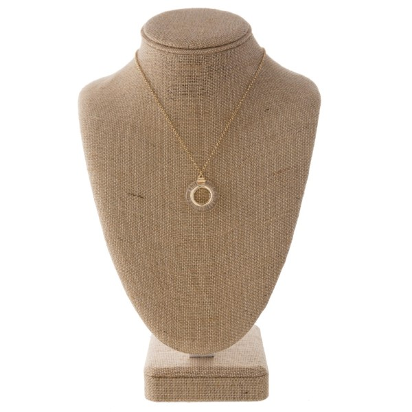 """Short gold tone necklace with acetate pendant. Approximately 18"""" in length.  