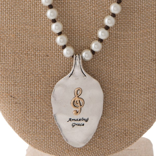 """Long pearl necklace with spoon pendant stamped with Amazing Grace. Approximately 30"""" in length with a 2"""" spoon."""