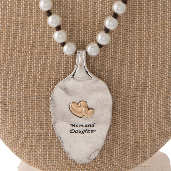 "Long pearl necklace with spoon pendant stamped with Mom & Daughter. Approximately 30"" in length with a 2"" spoon."