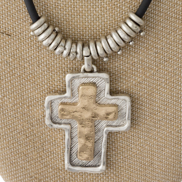 """Cord necklace with metal cross pendant. Approximately 20"""" in length."""