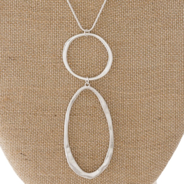 "Long metal necklace with oval pendant. Approximately 32"" in length with a 3.5"" pendant."