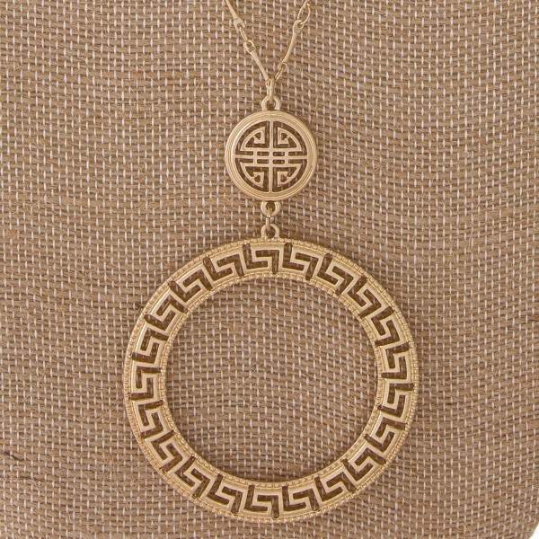 "Long metal necklace with boho cutout pendant. Approximately 32"" in length with a 2.5"" pendant."