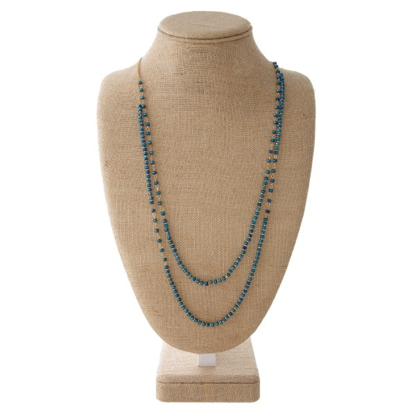 """Short silver tone necklace with wave detail. Approximately 18"""" in length."""