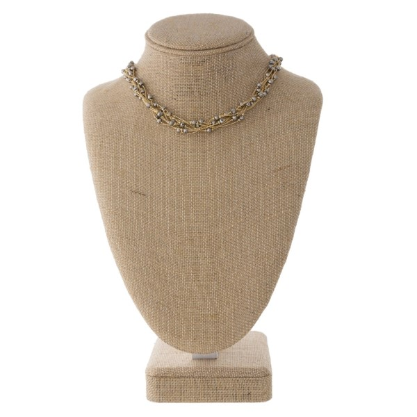 "Short necklace with pearl detail. Approximately 16"" with a 3"" extender."