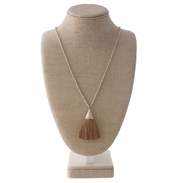"""Long necklace with faceted beads and soft thread tassel. Approximately 32"""" in length with a 3"""" pendant."""