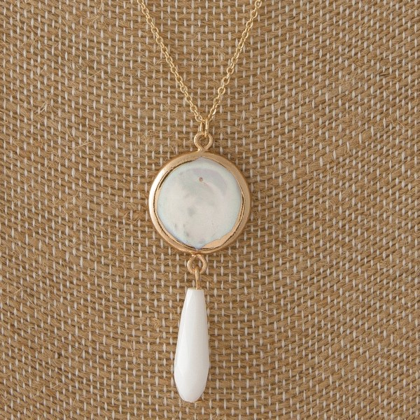 "Dainty necklace with pearl charm. Approximately 18"" in length."