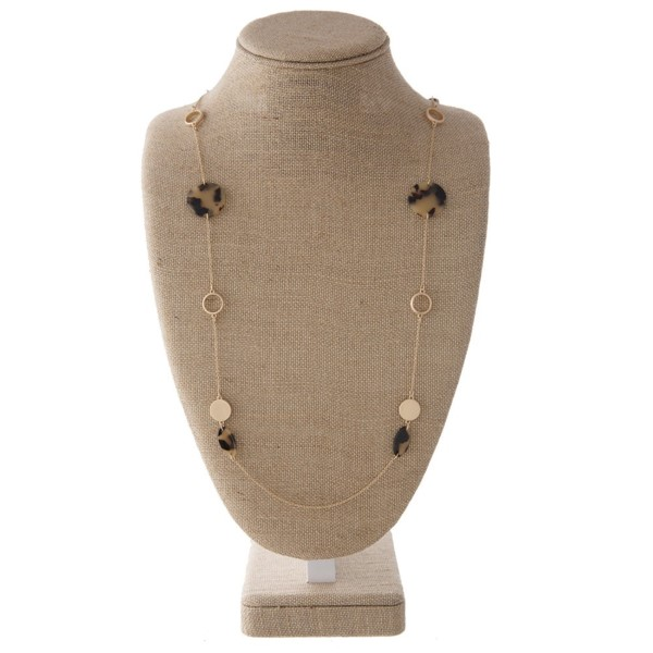 """Long necklace with metal and acetate details. Approximately 30"""" In length."""
