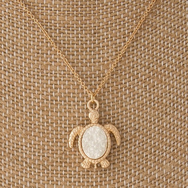 "Gold tone necklace with turtle charm. Approximately 18"" in length."