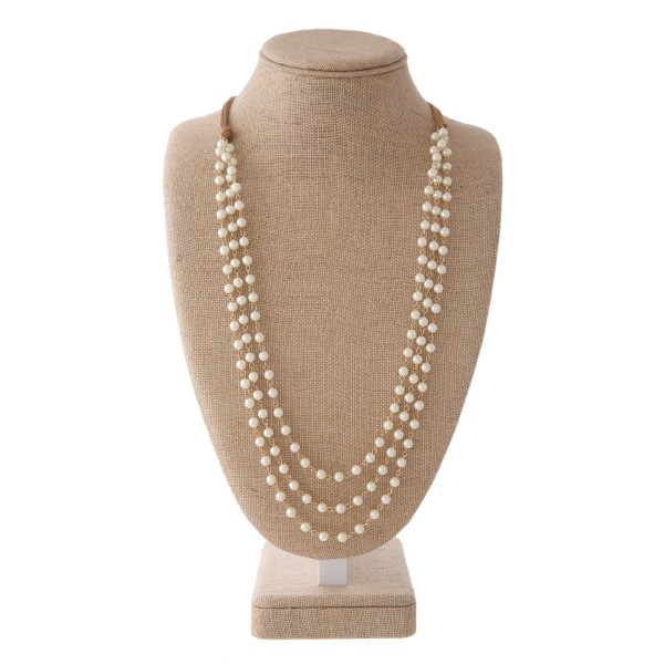 """Long layered necklace with waxed cord and natural stone detail. Approximately 30"""" in length."""