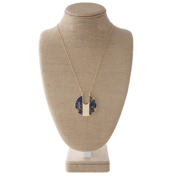 """Gold tone necklace with acetate circle pendant. Approximately 32"""" in length with a 2"""" pendant."""