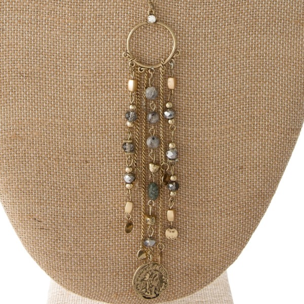 "Long metal necklace with coin and natural stone bead accents. Approximately 30"" in length with 4.5"" pendant."