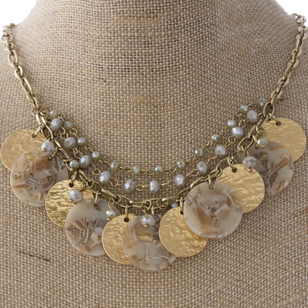 """Gold tone metal necklace with acetate and hammered metal circles. Approximately 20"""" in length."""