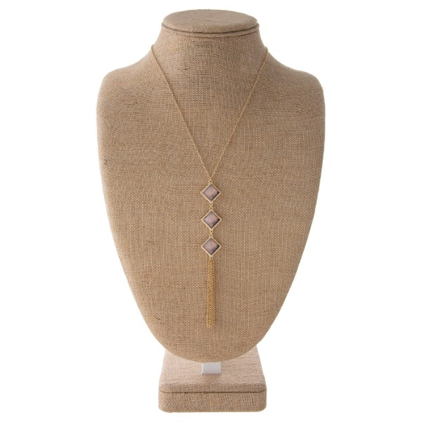 """Long gold tone necklace with three square pendant and metal tassel. Approximately 32"""" in length with a 4"""" pendant/tassel."""