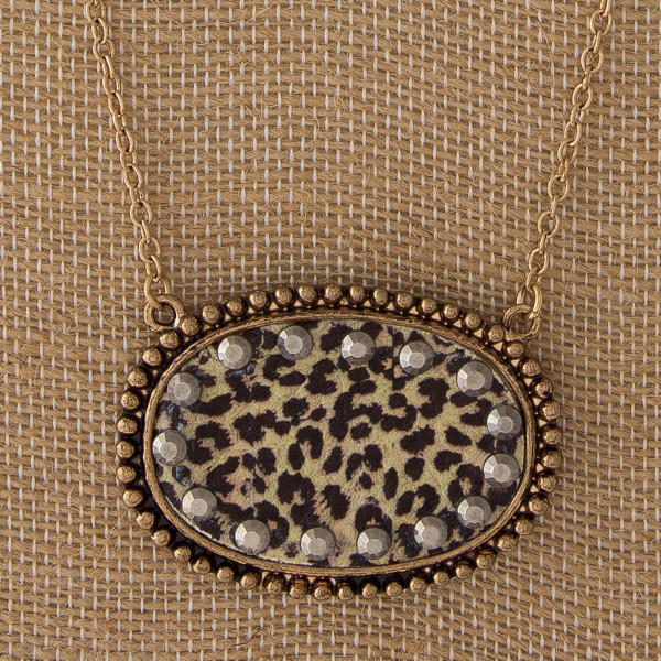 """Long metal necklace with leopard oval focal. Approximately 32"""" in length."""