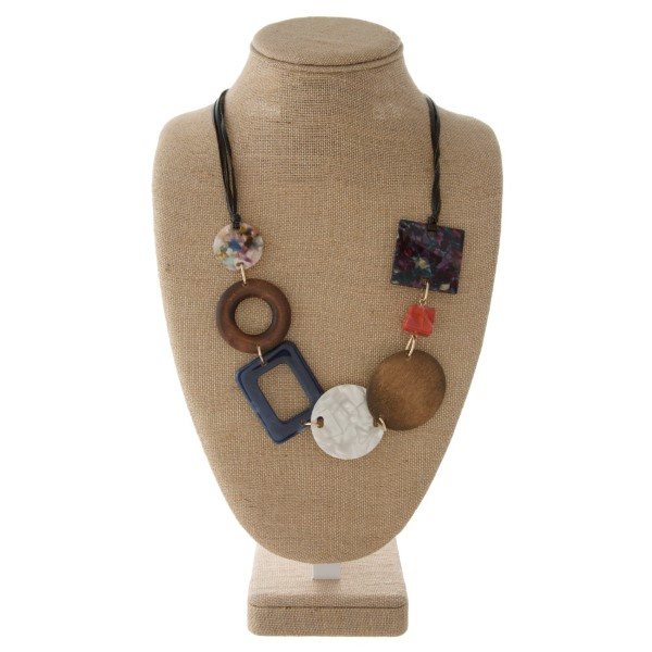 """Faux leather cord necklace with acetate and wooden details. Approximately 26"""" in length."""