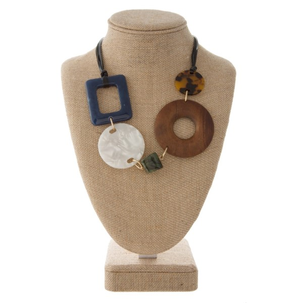 """Faux leather cord necklace with acetate and wooden details. Approximately 20"""" in length."""