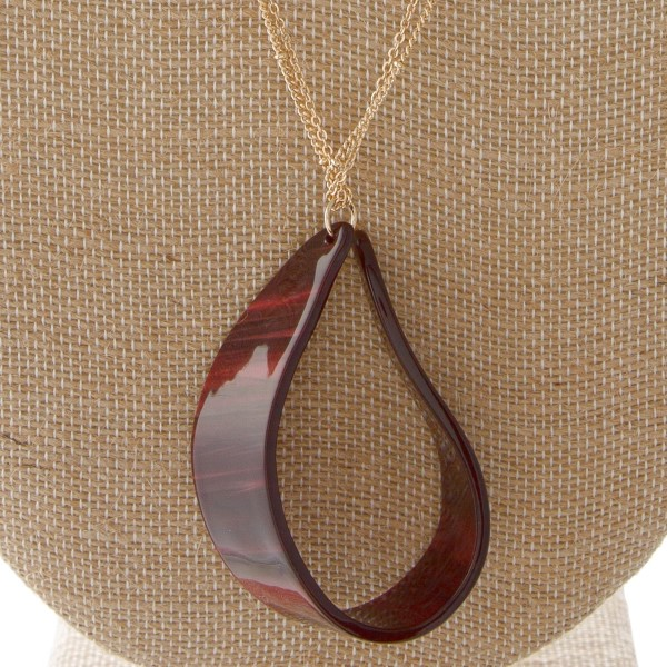 "Two layered gold chain necklace featuring a resin inspired teardrop pendant. Pendant 2.5"". Approximately 36"" in length overall."