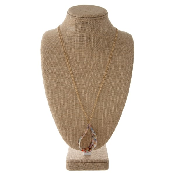 "Long gold tone chain necklace with acetate teardrop pendant. Approximately 30"" in length with a 2"" pendant."