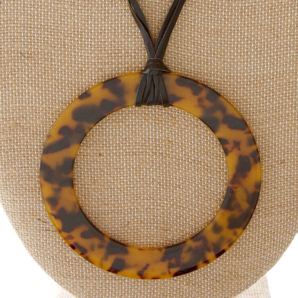 """Faux leather cord necklace with acetate circle pendant. Approximately 34"""" in length with a 4"""" pendant."""