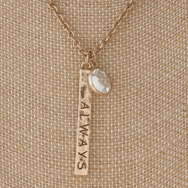 """Short necklace with rhinestone charm and doubled sided bar stamped with Always Believe. Approximately 16"""" in length."""