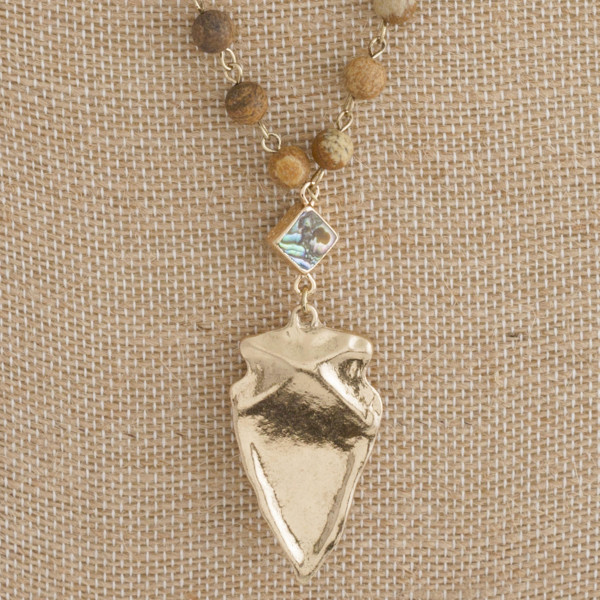 "Short natural stone necklace with gold arrowhead pendant. Approximately 18"" in length."