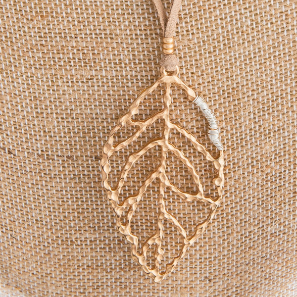 """Faux leather cord necklace with leaf pendant. Approximately 32"""" in length with a 2.5"""" pendant."""