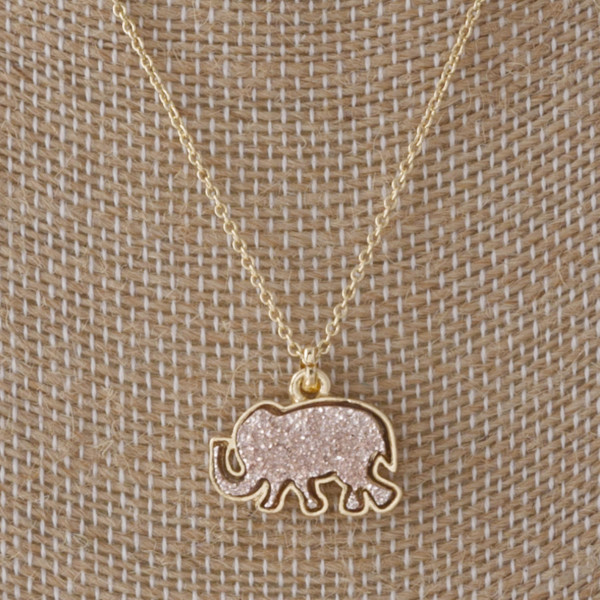 "Short gold necklace with faux druzy elephant charm. Approximately 16"" in length."