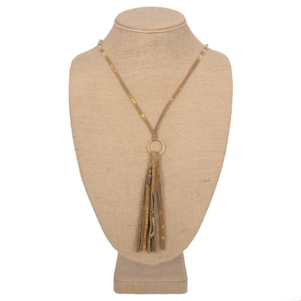 """Long faux leather necklace with tassel. Approximately 28"""" in length with a 4"""" tassel."""