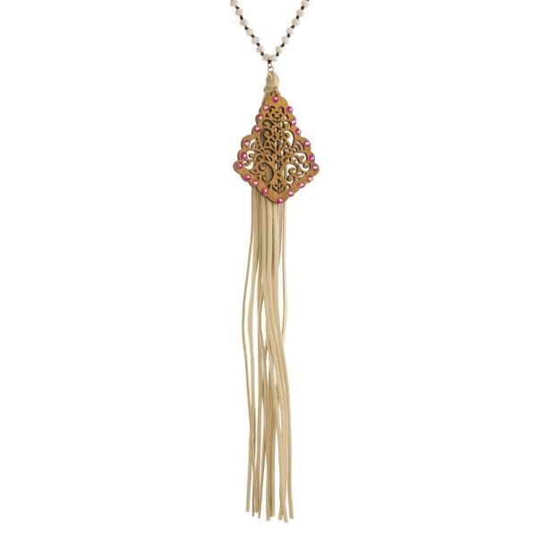 """Long beaded necklace with filigree pendant and long faux leather tassel. Approximately 32"""" in length with a 10"""" tassel."""