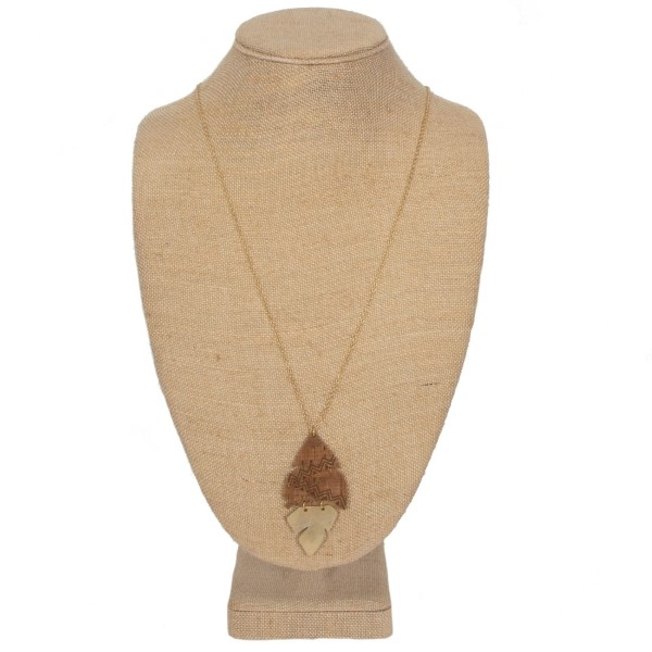 "Long necklace with cork pendant. Approximately 32"" in length."
