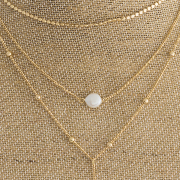 Long Y shaped layered necklace with pearl center