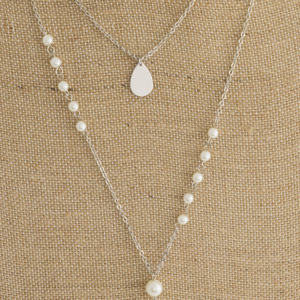 Three layered Y necklace with pearls and crystal center.