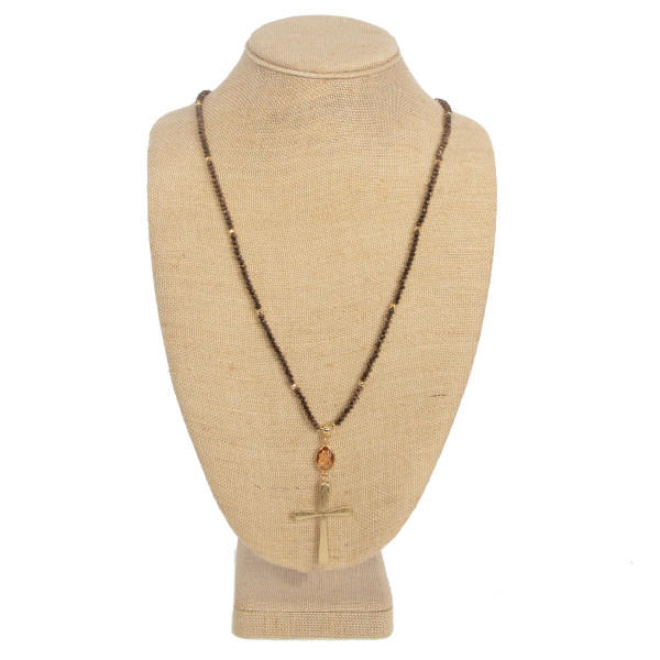 """Long necklace with faceted beads and cross detail. Approximately 32"""" in length."""