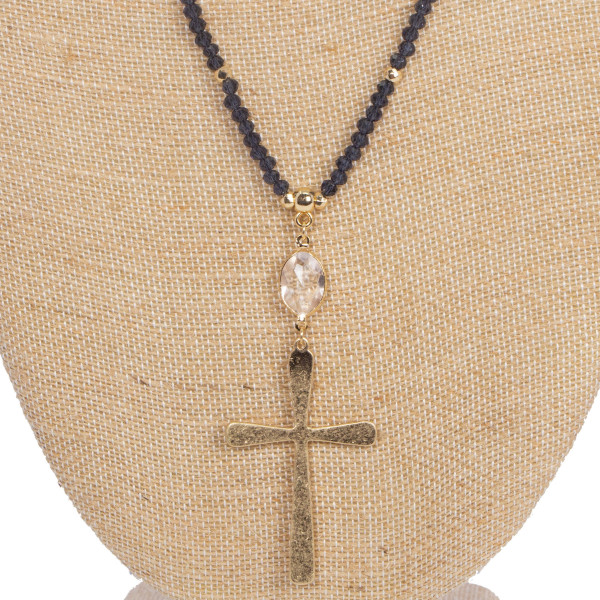 "Long necklace with faceted beads and cross detail. Approximately 32"" in length."