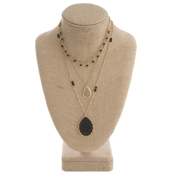"Layered necklace with filigree pendant. Approximately 16-22"" in length."