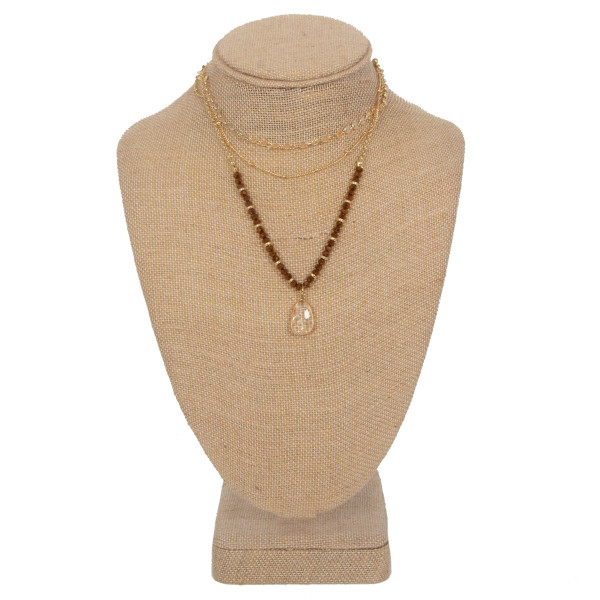 """Layered necklace with faceted beads and crystal charm. Approximately 16"""" in length."""